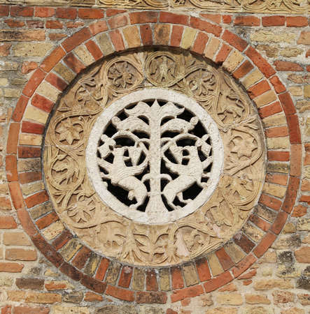 po valley: Detail in the wall of ancient Abbey of Pomposa historic church in the Po Valley near Ferrara in Italy