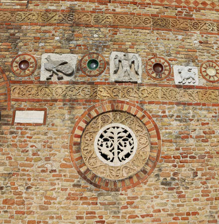 po valley: Detail in the wall of ancient Abbey of Pomposa historic building in the Po Valley near Ferrara in Italy Editorial
