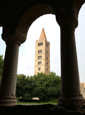 abbazia: highest ancient Bell Tower of the famous Abbey of Pomposa historic building in the Po Valley near Ferrara in Italy Editorial