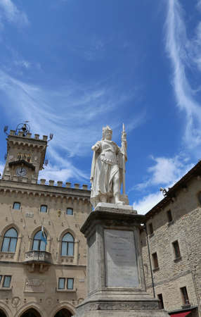 Statue of Liberty in the main square of microstate of San Marino and the ancient palace called Palazzo Pubblico seat of Government in Central Italy