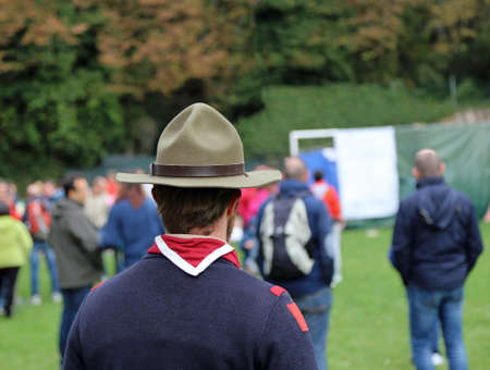 scout chief at international meeting in uniform with campaign hat and neckerchief white and red Stock Photo