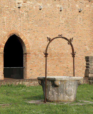 pompous: ancient well to collect rain water in the Pomposa Abbey in Italy