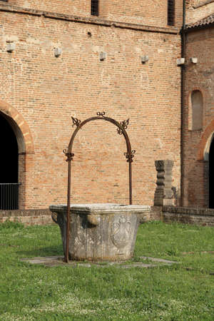abbazia: old well to collect rain water in the Pomposa Abbey in Italy Editorial