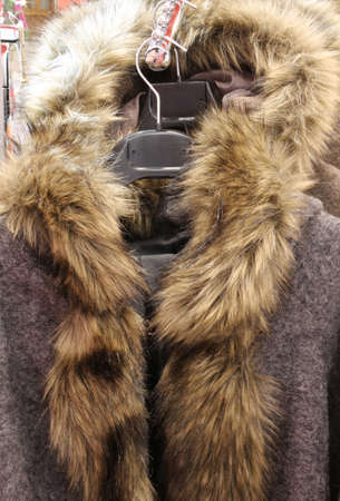 coat for women with fur collar for sale at flea market Stock Photo