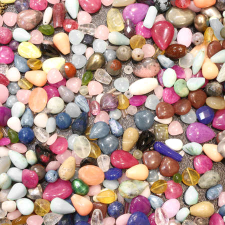 tough: tough polished stones for necklaces and decorations for sale at market