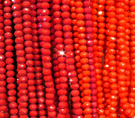 luxuriously: necklaces background of shiny red beads for sale in shop