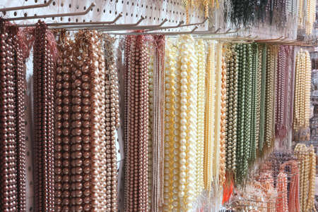 Many shimmering pearl necklaces for sale in jewelery shop Stock Photo