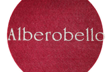 alberobello Written of an Italian City on fabric background and characters in glitter gleaming