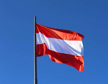 onu: big Austrian flag waving in the blue cloudless sky Stock Photo