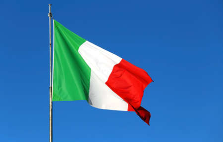 big Italian flag waving in the sky without clouds Stock Photo