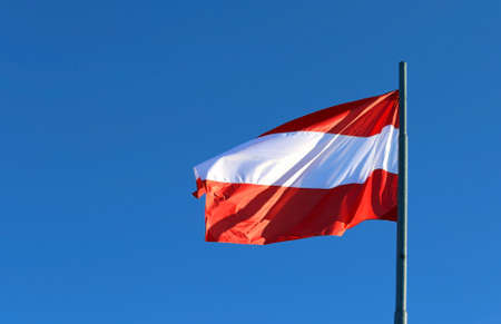 waved: Austrian flag waving in the blue cloudless sky