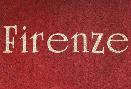 firenze: firenze Written of an Italian City on red fabric background