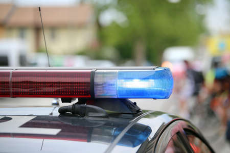 delinquent: blue flashing lights of the police car at a sports event in the city Stock Photo