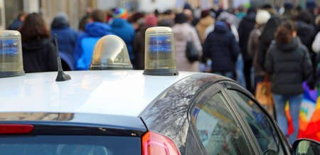 protesters: police car escorted the protesters during a street protest in the city Stock Photo