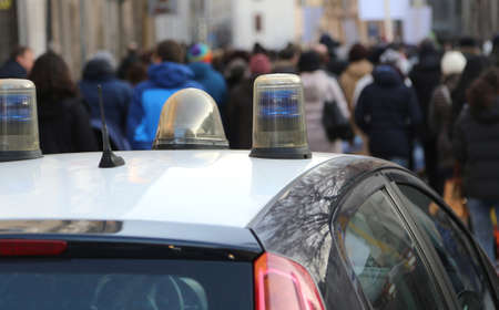 escorted: police car escorted the protesters during a street protest in the city Stock Photo