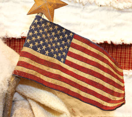 houston flag: American flag fabric with wooden stick and a star above
