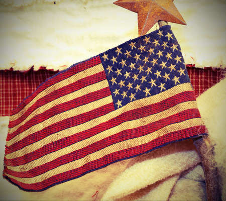 houston flag: old American flag with wooden stick and a star above Stock Photo