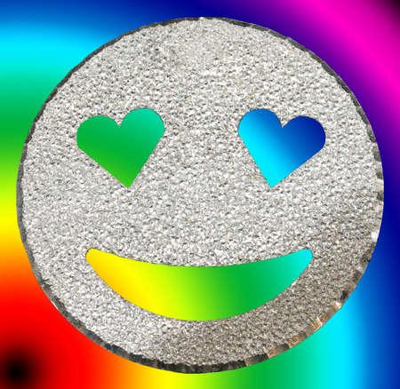 big smiling face shining with heart-shaped eyes on rainbow background