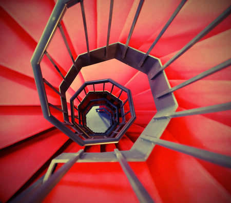 very long red spiral staircase without end