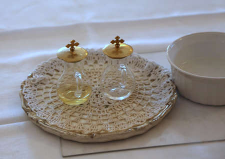 cruets for wine and water blessed during Catholic religious celebration