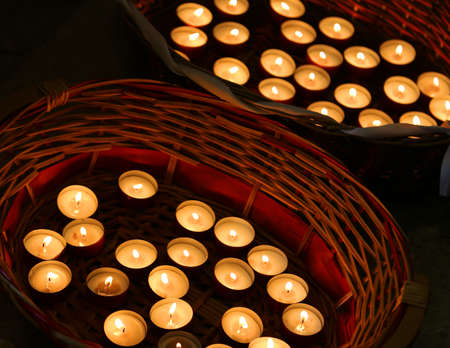 plea: candles lit in the wicker basket during the religious celebration