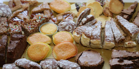 sweetened: pastries and tasty slices of cake for sale in bakery Stock Photo