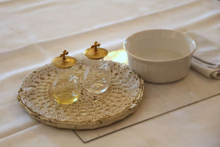 cruets for wine and holy water blessed during Catholic religious celebration