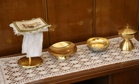 chalice: golden chalice and paten for Holy Communion during the Mass of the Catholic religious ceremony