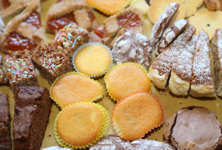 obesidad infantil: homemade cookies and delicious slices of cake at birthday party Foto de archivo