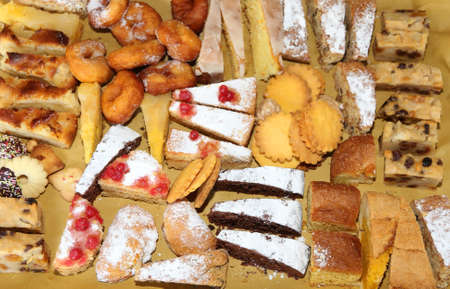 malnutrition: many slices of cake and pastries on sale in the bakery