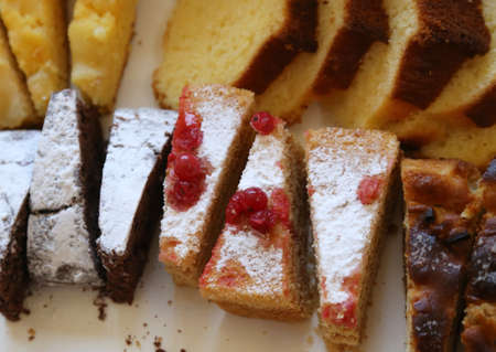 luscious: luscious slice of homemade cake with red currants and sugar