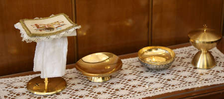 liturgical: golden chalice and paten for Holy Communion during the Mass of the Catholic religious ceremony