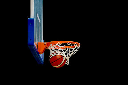 enters: basketball enters the basket with a completely black background