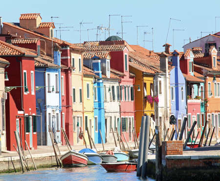 colourfully: Colourfully painted houses on Canal in Burano island near Venice in northen Italy Stock Photo