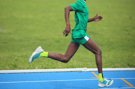jamaican man: Young African athlete won the foot race with long steps Stock Photo