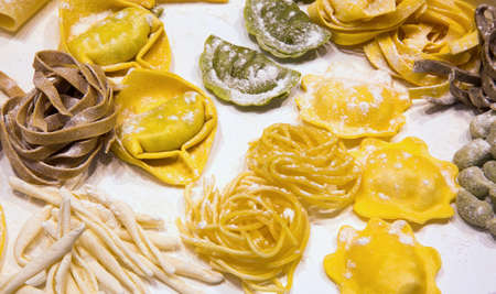 tortellini: Italian fresh pasta stuffed tortellini and homemade noodles with eggs and flour Stock Photo