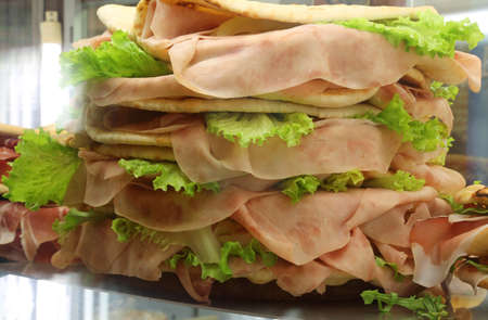 jambon: big piadina tortillas of bread  with ham and salad  for sale in the cafeteria Stock Photo