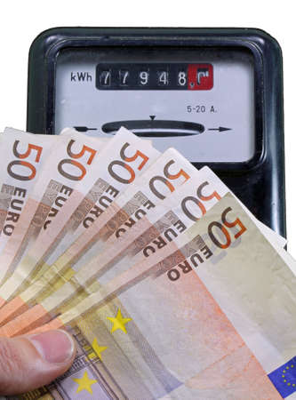 consumed: euro banknotes to pay the electricity bill and the meter for measuring electricity consumed