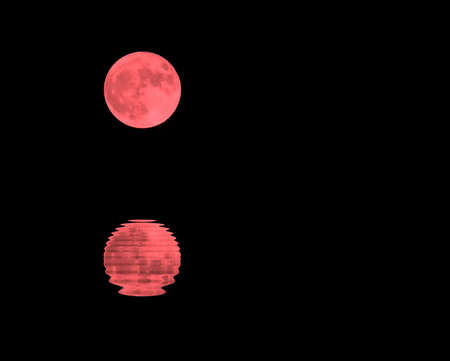 augury: red moon in the dark sky on a night and the sea Stock Photo