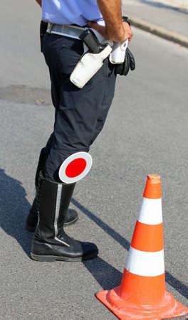 traffic warden: policeman with red paddle traffic on the street Stock Photo