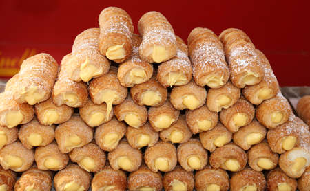 many cakes and cannoli cream for sale in Italian pastry