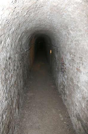 passage: long tunnel of a secret underground passage
