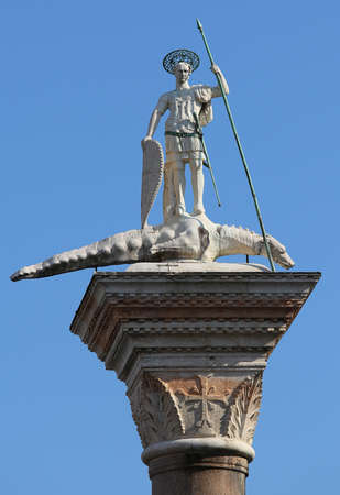 Saint Theodore slaying the dragon over the column in the square in Venice in Italy