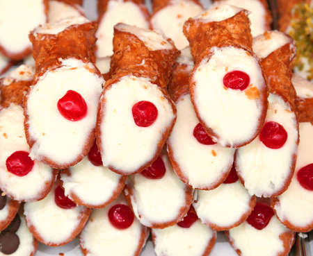 cannoli pastry: typical Sicilian pastries called CANNOLI with pastry cream for sale in pastry