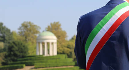 Italian mayor with the tricolor flag at a public event outdoors