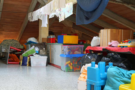 lot of stuff and clothes hanging in the attic of a nursery school