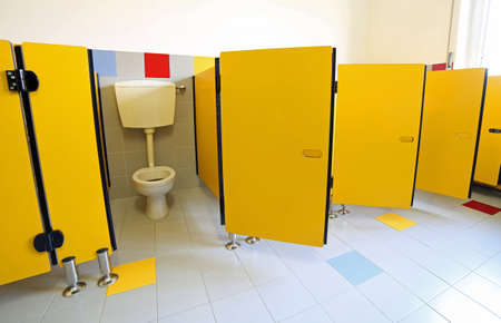 many baby baths in the bathroom of preschool without children