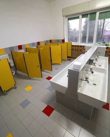 wide bathroom  for children in the kindergarten without people