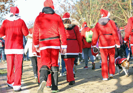 people run during the sporting event called Running with Santa Claus at Christmas Stock Photo