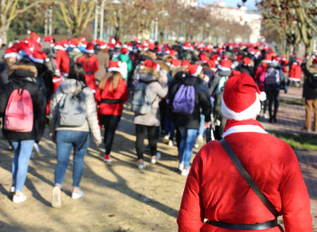 many people and students dressed as Santa Claus during the event called Running with Santa Claus at Christmas